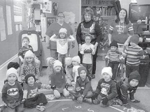 Grayson Holbrook and Shirley Sexton delivered winter hats and gloves to preschool classes at West Whitesburg Elementary School. Pictured is the morning class taught by Melissa Addington, (first row, left to right) Bishop Sexton, Colton Webb, Isabella Hall, Peyton Day, Kamden Collins, Magnus Morrell, (second row) Max Sexton, Aubrey Fleming, Gracie Gilley, Paisley Stamper, Jaci Hogg, (third row) Linkin Adams, Lilah Baker, Trigg Whisenant, Adam Caudill, Parker Sexton, (back row) Grayson Holbrook, Shirley Sexton and Melissa Addington.