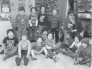 Melissa Addington's afternoon preschool class at West Whitesburg Elementary School wear the winter hats and gloves brought by Shirley Sexton and Grayson Holbrook. From left to right are (back row) Cole Campbell, Keeton Cook, Cashmire Johnson, Hunter Mullins, Logan Wright, (front row) Nathaniel Morton, Arrianna Profitt, Kloe Ramirez, Keira Bell and Carter Cook.