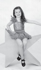 Elise Hill, 6, poses in her dance outfit. She is the daughter of Rocki and Matt Hill and the granddaughter of Robert Hatton and the late Joan Trent Hatton. She is the great-granddaughter of Oma Hatton.