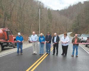 Pictured attending a ribbon-cutting ceremony in the Tolson Creek community are Letcher Fire and Rescue Chief Gary Rogers, State Sen. Johnny Ray Turner, State Rep. Leslie Combs, Letcher County Judge/Executive Jim Ward, Rev. Elwood Cornett, Mary Holbrook, chief district engineer for Kentucky Transportation Cabinet District 12, and Magistrate Woody Holbrook.
