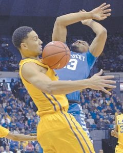 LSU forward Ben Simmons, left, and Kentucky guard Isaiah Briscoe (13) battled for control of a rebound in the first half of Kentucky's loss in Baton Rouge, Louisiana on Tuesday. (AP Photo)