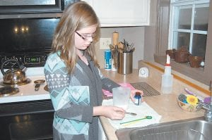 GOOD CLEAN FUN — 11-year-old Laura Collins has turned a purchase of a simple soap-making kit into a successful family soap-making business with her parents at their Payne Gap home. (Photo by Sally Barto)
