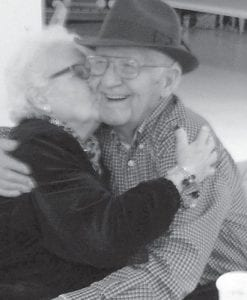 Bill Blair and Jo Ann Hall hugged on the final day of the Fleming-Neon Senior Citizens Program at the Hemphill Community Center. (Photo by Starla Hampton)