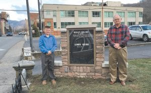 Robbie Campbell, owner of Letcher Funeral Home, and his grandson, Noah Campbell posed for a photograph with the new stone obituary board at the funeral home.