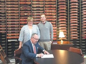 """FIRST TO FILE — James """"Jimmy"""" Craft II, of Eolia, filed to run for Letcher Circuit Judge on January 8. at the secretary of state's office in Frankfort. His wife, Kim, and son, James Craft III, are also pictured."""