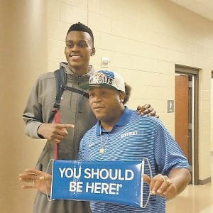 Junior Jarred Vanderbilt (left) had no trouble understanding where this fan attending the McCracken County Mustang Madness wants him to play his college basketball. (Larry Vaught/Verizon Photo)
