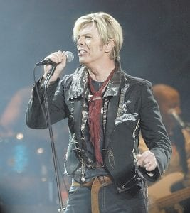 """In this Dec. 15, 2003 file photo, singer/songwriter David Bowie launches his United States leg of his worldwide tour called """"A Reality Tour,"""" at Madison Square Garden in New York. Bowie, the innovative and iconic singer whose illustrious career lasted five decades, died Mondayafter battling cancer for 18 months. He was 69 (AP Photo)"""