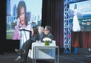 "Songwriter/singer Loretta Lynn (via satellite), from left, producers Michael Kantor, from left, Elizabeth Trojian and Elliott Halpern participated in the ""Loretta Lynn: Still a Mountain Girl"" panel at the PBS Winter TCA recently in Pasadena, Calif. (Invision/AP)"