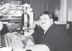 """Kevin Day is pictured on his birthday, doing what he loves to do at the WXKQ radio station. Whitesburg correspondent Oma Hatton says, """"He is a super nice fellow, with a great voice."""""""