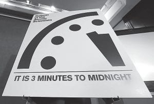 "A sign showing the ""Doomsday Clock"" that remains at three minutes to midnight is seen after it was unveiled by the Bulletin of the Atomic Scientists during a news conference this week at the National Press Club in Washington. The clock was last moved January 2015, from five minutes to three minutes before midnight, the closest it has been to catastrophe since the days of hydrogen bomb testing. (AP Photo)"