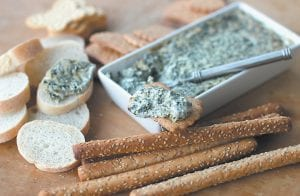 """Hot-And-Creamy Pesto Spinach Dip"" is seen in this photo. This dish is from a recipe by cookbook author Katie Workman, whose two books focus on family-friendly recipes. (AP Photo/Matthew Mead)"