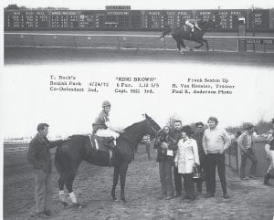 Thomas Back's thoroughbred racehorse King Brown, with Letcher County native Frank Sexton in the saddle, dominated the field in this April 1972 race at Beulah Park, then located near Columbus, Ohio. Back is seen standing second from the left of King Brown, a horse which he bought for only $1,500.