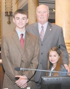 PAGES — Senator Johnny Ray Turner, D-Prestonsburg, recently honored his legislative pages on the floor of the Kentucky State Senate. Zachary Clay Hall, 11, is in the sixth grade at Whitesburg Middle School. Molly Hall, 6, is a first grader at West Whitesburg Elementary School. They are the children of Brandee and Charles Hall of Whitesburg and were accompanied to Frankfort by their grandmother, Eleanor Caudill. Photo by LRC Public Information.
