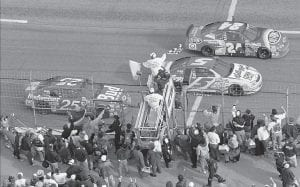 The sports world was abuzz this week in 1997 when Jeff Gordon, from Pittsboro, Indiana, became the youngest driver ever to win the Daytona 500 NASCAR race. In the photo above, Gordon, driving the DuPont Refinishes Chevrolet (24) followed by Terry Labonte, from Corpus Christi, Texas, driving the Kellogg's Chevrolet, and Ricky Craven, from Newburgh, Maine, took the checkered flag to finish 1-2-3 during the Daytona 500 held February 16 at Daytona International Speedway in Daytona Beach, Fla. (AP Photo/Phil Coale)