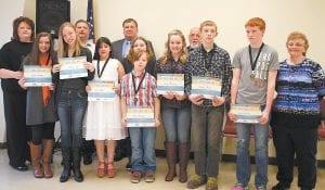 Letcher Middle School seventh grader Faith Back won the Letcher County Public Schools spelling bee held February 5 at the Letcher County School Bus Garage. Kaylee Whitaker, an eighth grader at Whitesburg Middle School, placed second and Jordan Osborne, an eighth grader at Arlie Boggs Elementary School, earned third place. Pictured (front row, left to right) are Kaylee Whitaker, Ruthie Lee, a fifth grader at West Whitesburg Elementary School, Fantanoel Allie Baker, a third grader at Martha Jane Potter Elementary School, Faith Back, Gary Manning, a fifth grader at Letcher Elementary School, Emma Quillen, a sixth grader at Fleming-Neon Middle School, Dakota Fields, a seventh grader at Cowan Elementary School, Jordan Osborne, (back row) Letcher District Director of Curriculum and Instruction Denise Yonts, Letcher District Director of Pupil Personnel Kenny Cornett, Letcher Supt. Tony Sergent, Mike Caudill, who served as the spelling bee moderator, and Letcher District Director of Special Education Regina Brown.