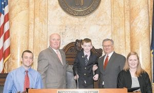 Eight-year-old Grant Edward Barto, a third-grade student at West Whitesburg Elementary School, served as a legislative page for State Sen. Johnny Ray Turner on Feb. 11. Pictured are Grant's father, Derek Barto, Turner, Grant, Kentucky Supreme Court Justice Samuel T. Wright III and Grant's mother, Sally Barto. Photo by LRC Public Information Office