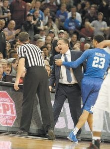 """""""Since Calipari has been at Kentucky I've never seen him so upset with any official,"""" writes columnist Larry Vaught. What will be interesting now is whether [referee Doug] Sirmons works any more UK games. My guess is no."""" (Photo by Vicki Graff )"""