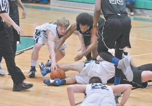 Letcher Central High School's Austin Caudill fought for a loose ball during last week's 53rd District Tournament championship game against June Buchanan. No. 22 for Letcher Central is Elijah Raglin. The Cougars will travel to Knott County Central in Hindman Thursday to play Buckhorn in the opening round of the 14th Regional Tournament. Tipoff is set for 8 p.m. (Photo by Chris Anderson)