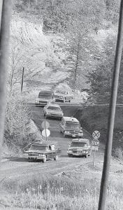 A line of hearses carrying the bodies of miners killed in an explosion at the Scotia Mine in March 1976 wound its way down a mountain road after the bodies were recovered from the Oven Fork mine more than eight months later. (AP Photo)