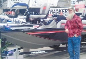 """Fishing columnist Greg """"Gabby"""" Caudill admires a bass boat decked out with LED lighting in Pikeville over the weekend."""
