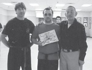 John Ng's Four Seasons Kung Fu and Tai Chi recently promoted Aaron Adams of Whitesburg to 1st Black Sash and instructor level one. Master Frank Sexton says Adams is one of the top students and is hard working and dedicated. Pictured are (left to right) Sexton, Adams and Ng.