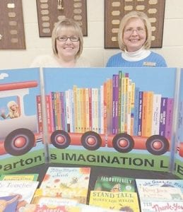 Martha Jane Potter Elementary School's annual Family Literacy Night was held March 3. The event included registration for the Dolly Parton Imagination Library with 12 children registering and receiving a free book. Once registered, children under five years old who live in Letcher County receive a free book each month. Pictured are (left to right) Teresa Branham from the Resource Center at MJP, and Whitesburg Rotarian Margaret Hammonds. For more information, call Margaret Hammonds at (606) 633- 8200. The Imagination Library is sponsored in Letcher County by the Rotary Club of Whitesburg.