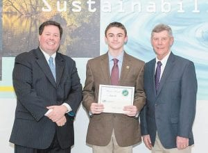 Todd Bright (left), Kentucky Farm Bureau, and David Rowlett, Kentucky Association of Conservation Districts, present Zachary Hall of Whitesburg Middle School with his award for his essay. (Photo by David Hargis, Kentucky Division of Conservation)