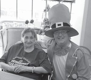 Residents of Letcher Manor Nursing Home celebrated St. Patrick's Day on March 17. They listened to Irish music and received a visit from a leprechaun. Pictured are Mr. Leprechaun (Wendell Bates, maintenance) and resident Dorothy Moore.