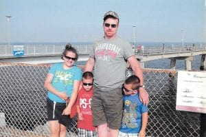 This photo shows Mark Wayne Frazier with three of his five children — daughter Katelyn Makayla Caudill and twin sons Mason Keith and Matthew Allen Frazier — during a stop at Chesapeake Bay Bridge-Tunnel in Virginia during family vacation. Funeral services for Frazier, 48, were held at Linefork on Tuesday, four days after he was killed in a mining accident in Harlan County.