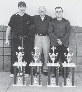 Master Frank Sexton of John Ng's Four Seasons Kung Fu and Tai Chi of Whitesburg, Pikeville and Hazard, and Aaron Adams of Whitesburg, competed in the Somerslam open martial arts tournament in Somerset. Sexton and his students will complete in several more state, regional and national tournaments during the years. Sexton was asked to join the U.S.A. World Competition Team, which will be traveling to Italy to compete in the world championships. He said he thanks his teacher, Great Grandmaster John Ng, for the knowledge and training and support that Ng has given him. Pictured are (left to right) Sexton, Ng, and instructor Aaron Adams.