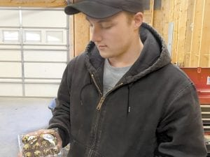 EGG MAN — What began as a hobby for Aaron Halcomb has become a potential moneymaker as he is using the Internet to sell quail eggs all across the nation. Halcomb, 21, is pictured with a dozen of the eggs.