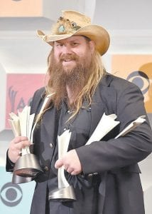 Breathitt County native Sturgill Simpson (left) will release his third album — and first release on a major label — on April 15. At right, former Johnson Central High School valedictorian Chris Stapleton is photographed with awards he won at Sunday's Academy of Country Music Awards event held in Nashville. (AP Photos)