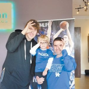 Kyle Wiltjer, left, put up the 3-goggles with fans during an autograph stop last week. (Photo by Larry Vaught)