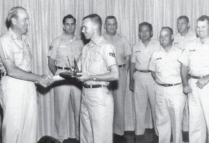 General Cunningham is shown handing out awards to Everett Vanover's bowling team when it won the Travis Air Force Base Championship. Eva Dale Douglas, who was from Letcher County, was General Cunningham's secretary, both in the Azores and at Scott Air Force Base in Illinois.