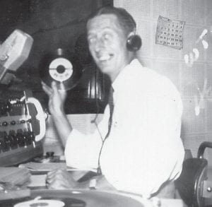 Hence Eversole is pictured in 1956 when he worked at WTCW Radio, 1450 on the dial.
