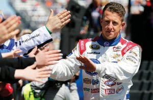 Sprint Cup Series driver A.J. Allmendinger greeted fans during driver introductions for the Sprint Cup auto race at Martinsville Speedway in Martinsville, Va. (AP Photo)