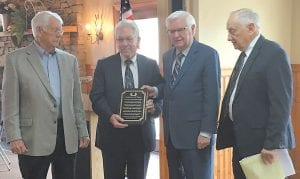 ROGERS HONORED FOR PRISON EFFORT — U.S. Rep. Hal Rogers, second from right, is presented with a plaque by Joe DePriest as fellow Letcher County Planning Commission members Don Childers, left, and Elwood Cornett, right, look on. (Photo by Sally Barto)