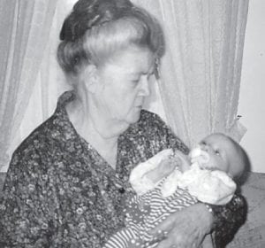 The late Cinda Howard, mother of Whitesburg correspondent Oma Hatton, holds her first great-great-grandchild, Taylor Shaffer, who is 21 years old now. Mrs. Howard died two weeks later at the age of 80.