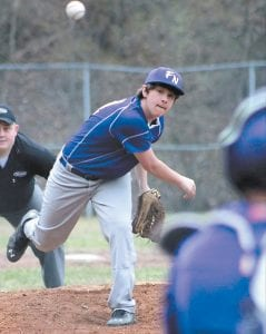 Eighth-grader Manny Gibson fires a pitch during his no-hitter against Wolfe County.