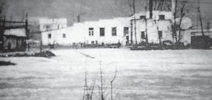 The Wardrip Meat Packing Plant near Letcher is shown here when it was surrounded by floodwaters in 1957. (Photo by Jim Cornett)