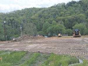 Work began this week on preparing the site in West Whitesburg where a new Taco Bell restaurant will be located. The restaurant will occupy the former Honeycutt property.