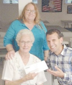The Hemphill Community Center has received a $5,000 grant from Appalshop, Inc. as part of its Creative Place Making Partnership. The funds will be used for the Hemphill Community Center Catering Company, which will launch on June 1. Pictured are (seated) Mable Johnson, Chairperson of Hemphill Community Center; Ben Fink of Roadside Theater/Appalshop, and (standing) Gwen Johnson.