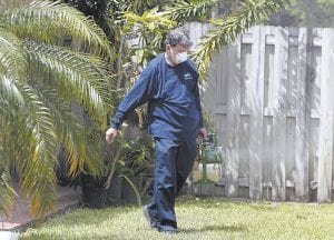 Giraldo Carratala, an inspector with the Miami-Dade County, Florida mosquito control unit, sprays pesticide in the yard of a home in Miami, Fla. (AP Photo)