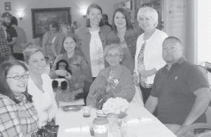 """Staff members at Letcher Manor Nursing and Rehabilitation said of Mother's Day, """"We celebrate the extraordinary importance of mothers in our lives. Mothers are the rocks of our families and a foundation in our communities. In gratitude for their generous love and lifelong support, let us remember our mothers who are with us and those who are no longer with us, but yet inspire us still."""" Joining the nursing home residents on Mother's Day were Judge/Executive Jim Ward and his wife Joan. Pictured are Georgia Adams and her family."""