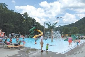 Forget the calendar that says summer doesn't begin until June 21. The summer season kicked off over the weekend in Letcher County with warm weather appearing to have finally arrived and the public swimming pool in Jenkins opening just in time for enjoyment by many families over the Memorial Day weekend. Temperatures were expected to reach a high of 86 degrees by the middle of this week. Unfortunately, the warmer weather is bringing with it a good chance for thunderstorms the rest of this week. (Eagle Photo)