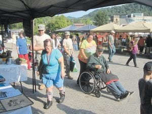 JROTC cadets from Letcher County Central High School assisted with the Farmers Market in downtown Whitesburg on Saturday. The cadets assisted the vendors with tent and stand setup and assisted the customers by carrying their bags, pushing their wheelchairs, and walking with them to assist as needed.