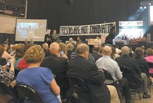 — A small group of citizens representing an organization called the Letcher County Governance Project staged a short protest against a planned federal prison slated for construction at Roxana during the SOAR meeting. The committee is supported by the Kentuckians for the Commonwealth (KFTC).