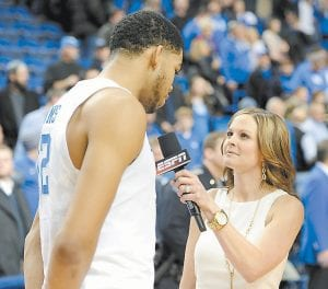 Shannon Spake likes the passion of Kentucky basketball fans and appreciates the way fans, coaches and players at Kentucky treat her while she's doing her job. (Photo by Vicky Graff )