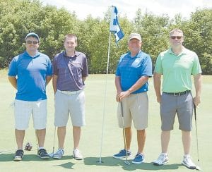 The winning team members in the Golf Scramble were (left to right) Dave Hampton, Bryan Fleming, Sam Quillen, Jr. and Denley Lucas.