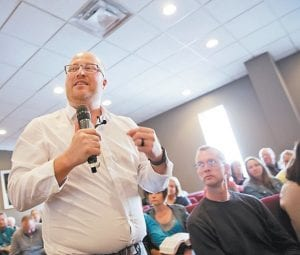 Lead pastor Richie Clendenen spoke recently during a service at the Christian Fellowship Church in Benton, Ky. Clendenen reflected on the gulf between his congregants and other Americans. (AP Photo)